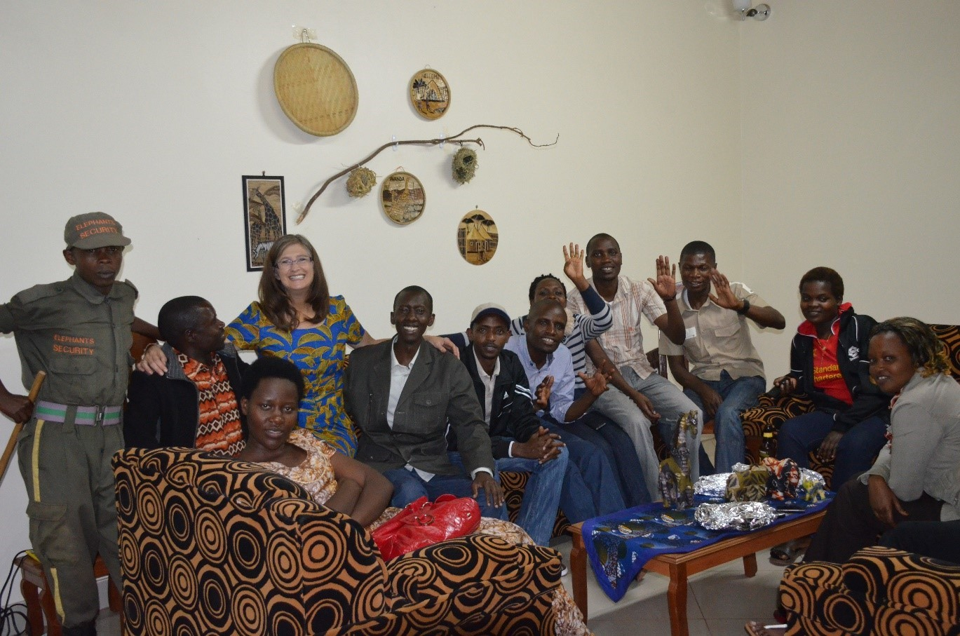 AANP Fellow Maria C. Kidner is surrounded by a group of health care providers in Rwanda