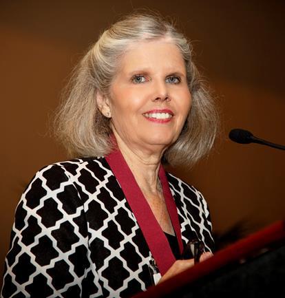Headshot of AANP Fellow Mary Jo Goolsby at a podium