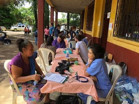 A health care provider speaks to a local patient in Guatemala